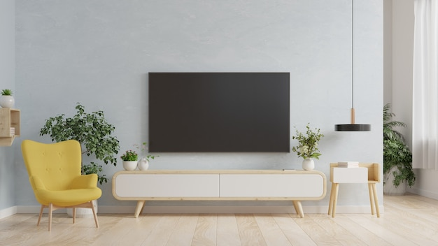Smart tv on the blue wall in living room with armchair,minimal design,3d rendering