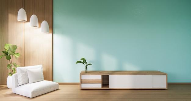 ミントの壁とアームチェア付きのリビングルームのキャビネットのスマートテレビ