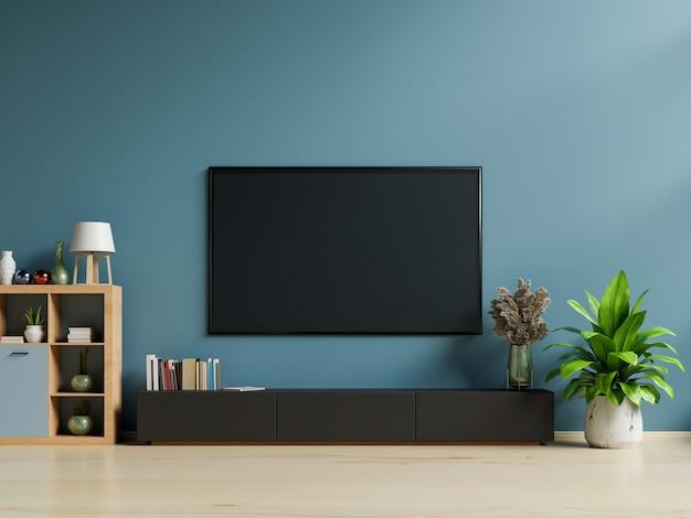 거실의 진한 파란색 벽에 스마트 Tv 프리미엄 사진