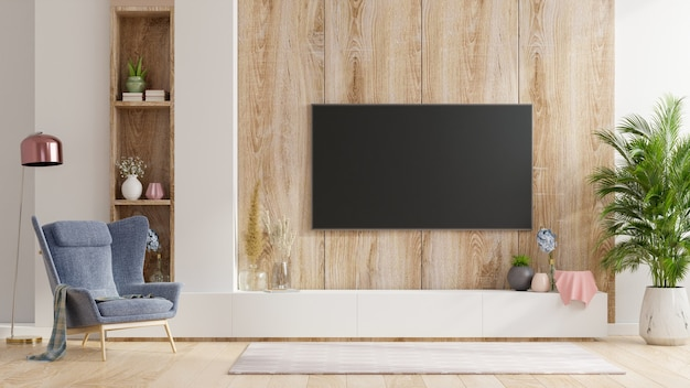 안락 의자가있는 거실의 나무 벽에 스마트 tv, 최소한의 디자인