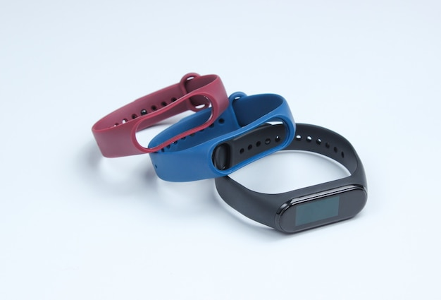 Smart watch with interchangeable bracelets on white background. fitness tracker. modern gadgets