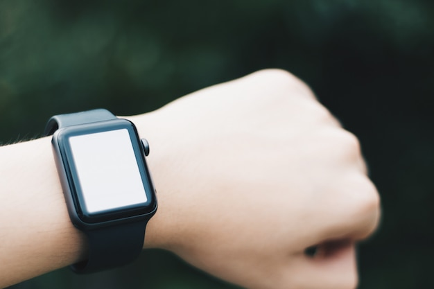 A smart watch on wrist with blank screen
