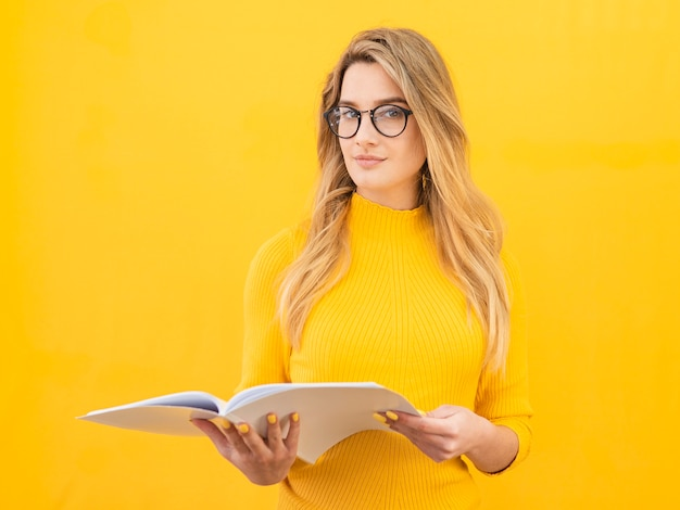 Smart woman with glasses and notebook