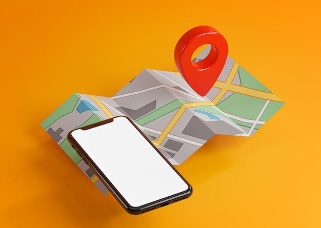 地図上のスマートフォンと赤いgpsピン。