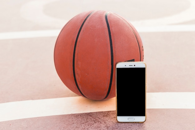 Smartphone and basketball in court
