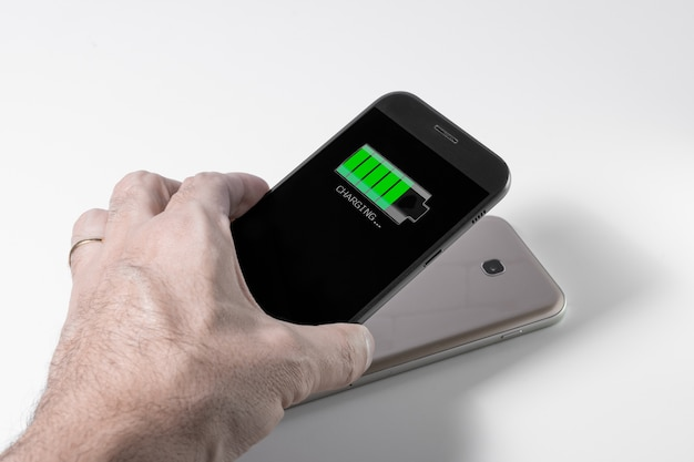 Smartphone being charged by another device via wireless charging