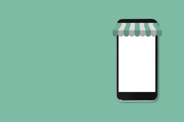 클리핑 패스와 함께 녹색 배경에 스마트폰 빈 흰색 화면. 모형 휴대 전화 빈 화면입니다. 온라인 쇼핑 개념입니다.