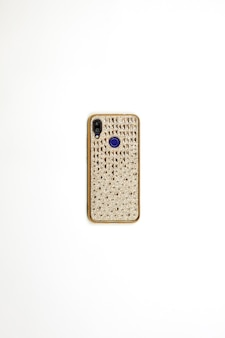 A smartphone in cover case decorated with golden stones