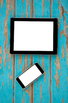 Smartphone and digital tablet on wooden table