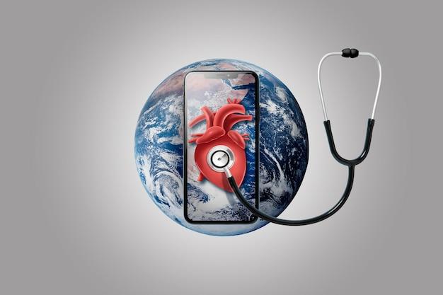 Smartphone sulla terra con lo stetoscopio su un cuore