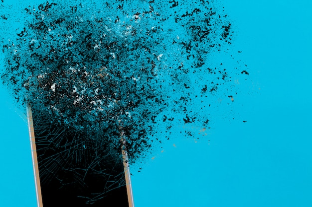 Smartphone explosion on blue. edit by using explosion effect