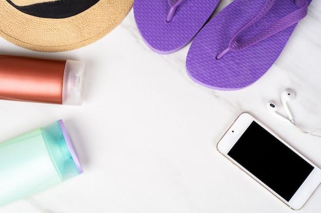 Smartphone, flip-flops, sunscreen and hat.