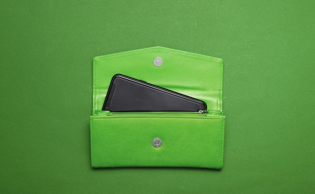 Smartphone in green leather wallet