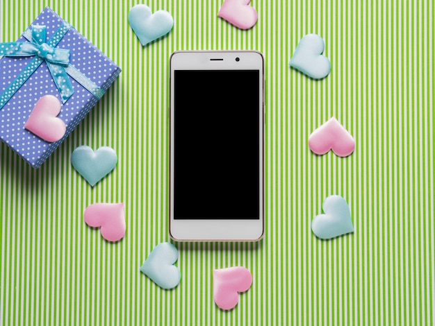 Smartphone, hearts and pastel gift box