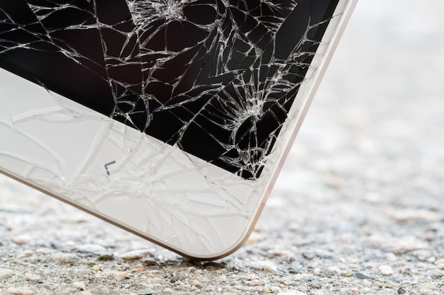 Smartphone hits the ground. broken display screen