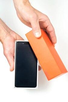 Smartphone in human hands.