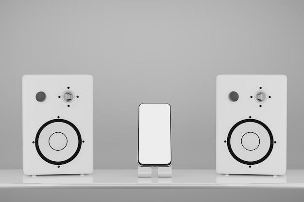 Макет смартфона посередине между белыми стереофоническими музыкальными динамиками 3d-рендеринга