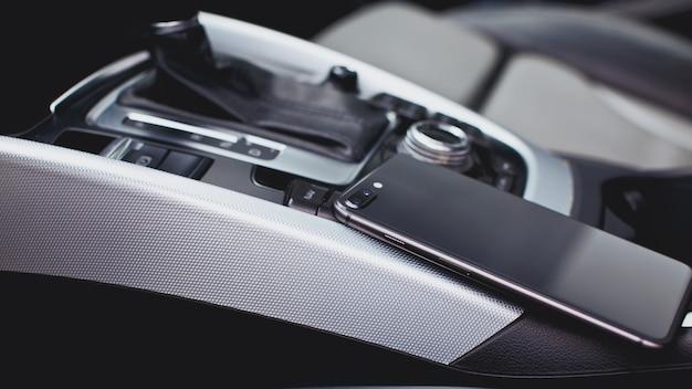 Smartphone on the modern car interior