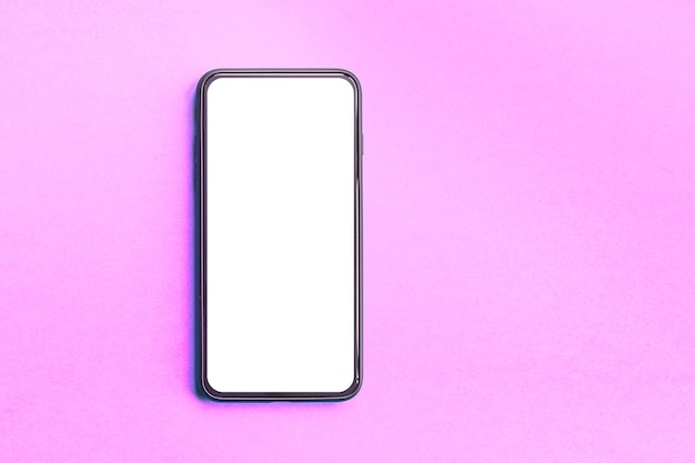 Smartphone on pink background with blank screen, copy space.