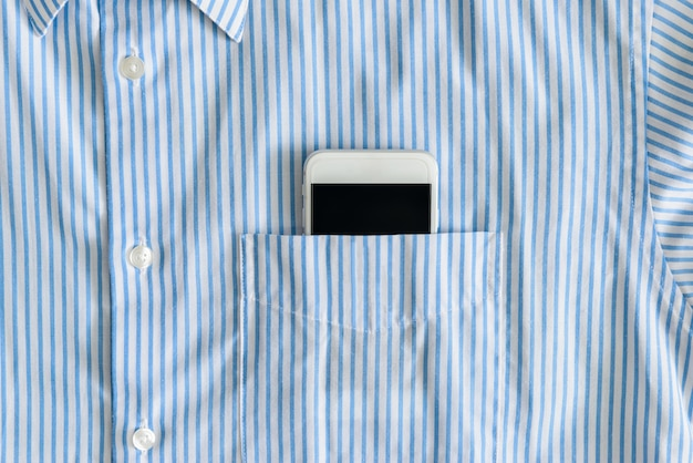 Smartphone in a pocket of shirt