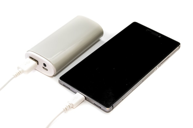 Smartphone and power bank isolated on white background