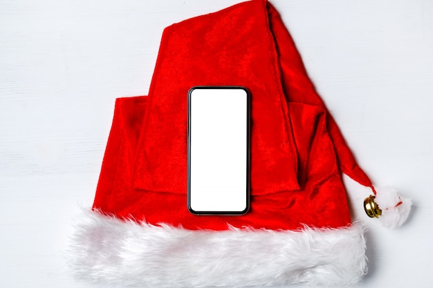 Smartphone on santa claus hat