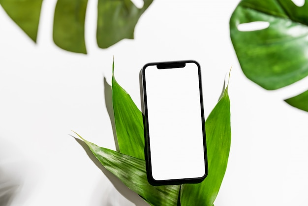 Smartphone screen blank on the table mock up to promote your products.