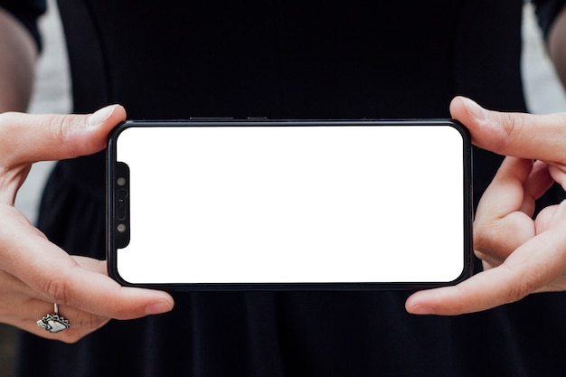 Smartphone screen hold by a person