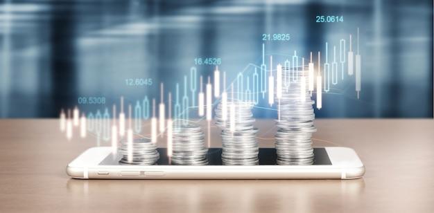 増え続けるコインの山の横にあるスマートフォンの画面と彼のビジネスにおけるポジティブな指標のチャート