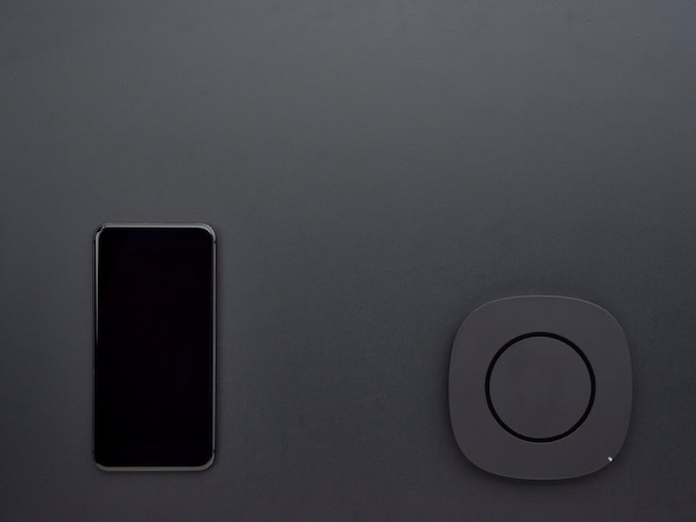 Smartphone with black wireless charger.