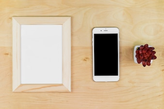 Smartphone with blank frame on table