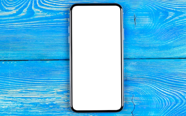 Smartphone with blank screen mock up. smartphone isolated screen with clipping path. mobile phone white screen with copy space on office desk. empty space for text. isolated white screen