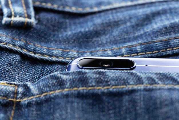 Smartphone with dual camera in back pocket of jeans