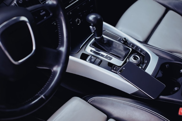 Smartphone with dual camera in the interior of a car
