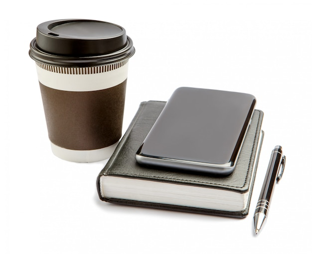 Smartphone with note pad and cup of strong coffee