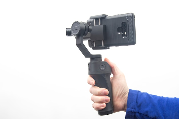 Smartphone with stabilizer on white background