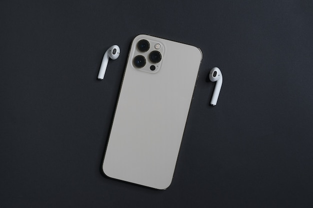Smartphone with white earphones