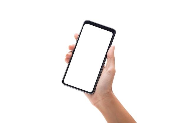 Рука женщины держа черный smartphone с пустым экраном изолированный