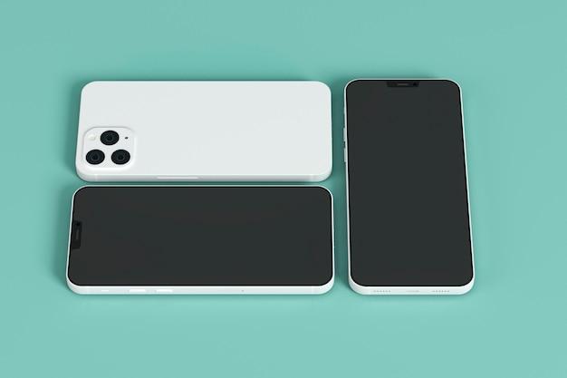 Смартфоны на зеленом фоне высоким углом