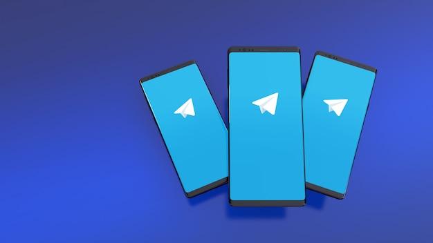 Смартфоны с логотипом telegram на экране над синим