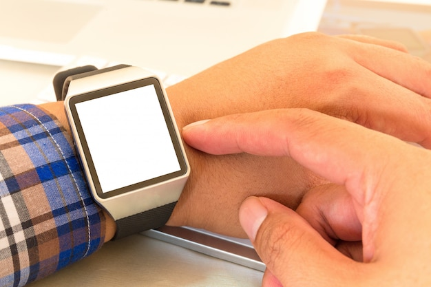 Smartwatch of businessman hands with with blank screen.