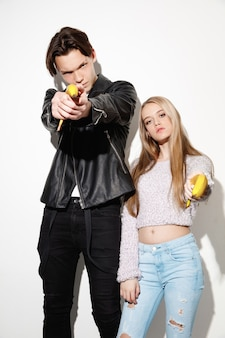 Smash outright. close up fashion portrait of two young cool hipster girl and boy wearing jeans wear.  two models having fun and making serious faces.