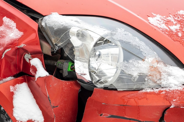 Smashed red car. car cracked headlight. high quality photo