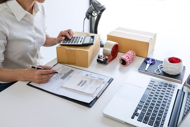 Sme entrepreneur owner delivery service and working packing box, business working checking order