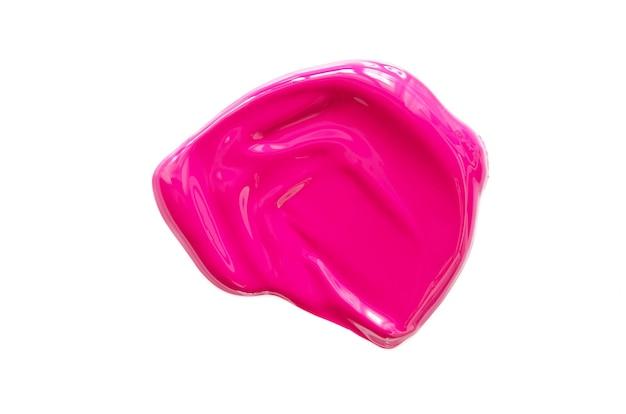 Мазок и текстура розовой помады или акриловой краски, изолированные на белой поверхности.