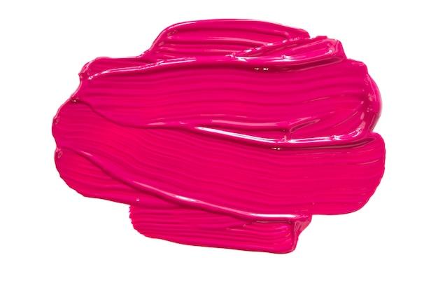 핑크 립스틱 또는 흰색 표면에 고립 된 아크릴 페인트의 얼룩과 질감.