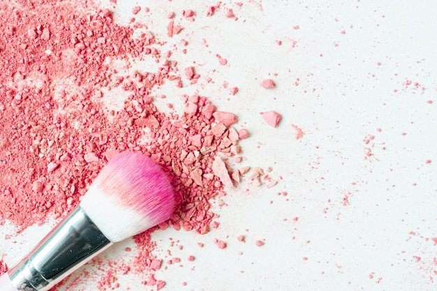 Smear of crushed pink blush on as sample of cosmetics product, copy space, top view