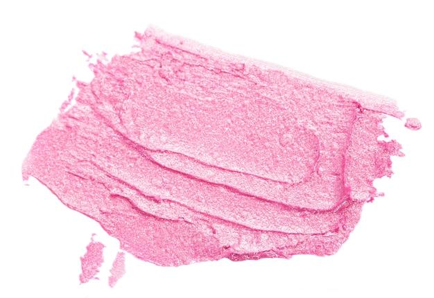 白で分離されたピンクの口紅の塗抹標本
