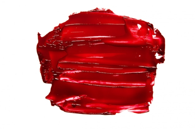 Smear and texture of red lipstick or oil paint isolated.