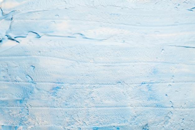 塗られた青いアクリル絵の具アート。しっくい壁効果抽象的な表面。